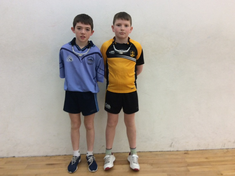 U-13 Singles player pictured before his game with a pupil of Loughmacrory PS.