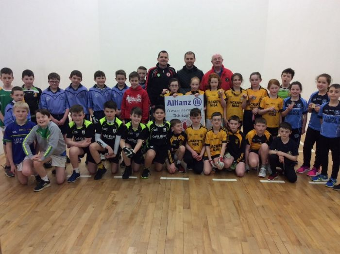 All the primary school handballers pictured at Loughmacrory alley along with the tournament organisers.