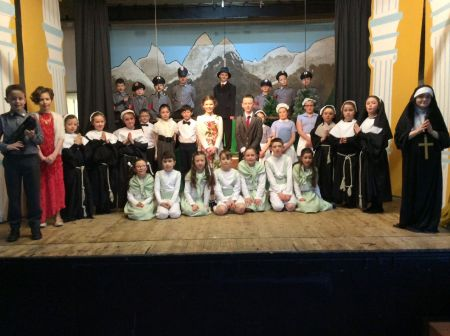 The whole cast pictured onstage.